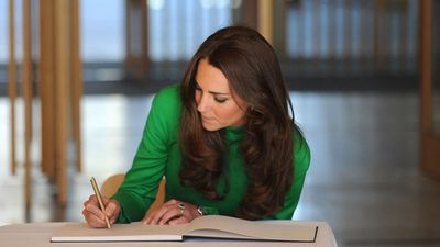 Duchess of Cambridge signs a book in the National Portrait Gallery, Canberra, 2014