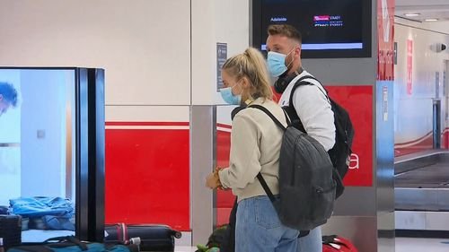 Passengers from Adelaide flight arrive in Sydney.