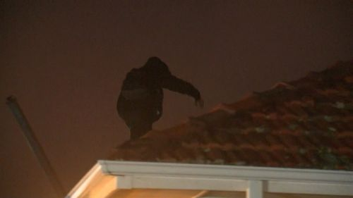 A man has been arrested after a rooftop siege.