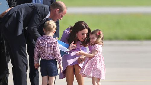 Princess Charlotte didn't appear too impressed at the sight of the helicopter. (AAP)