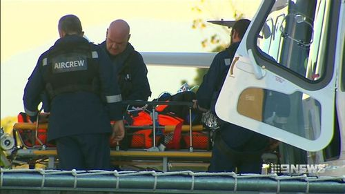 An air ambulance winched the pilot from the crash site, which was in remote bushland near Cabramurra. (9NEWS)