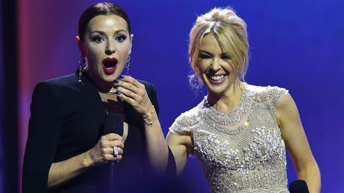 Tina Areana and Kylie Minogue on stage at the ARIAs. (AAP)
