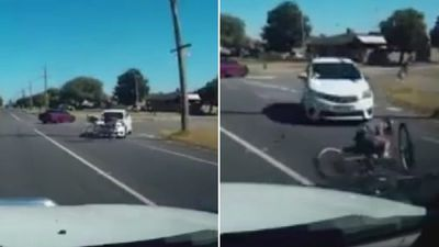 Cyclist walks away after being flung 10 metres by car