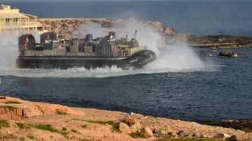 A US amphibious hovercraft departs with evacuees from Janzur, west of Tripoli, Libya.