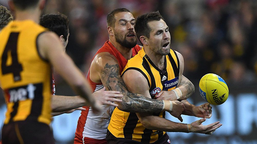 Hawks down Swans in tense AFL clash at MCG
