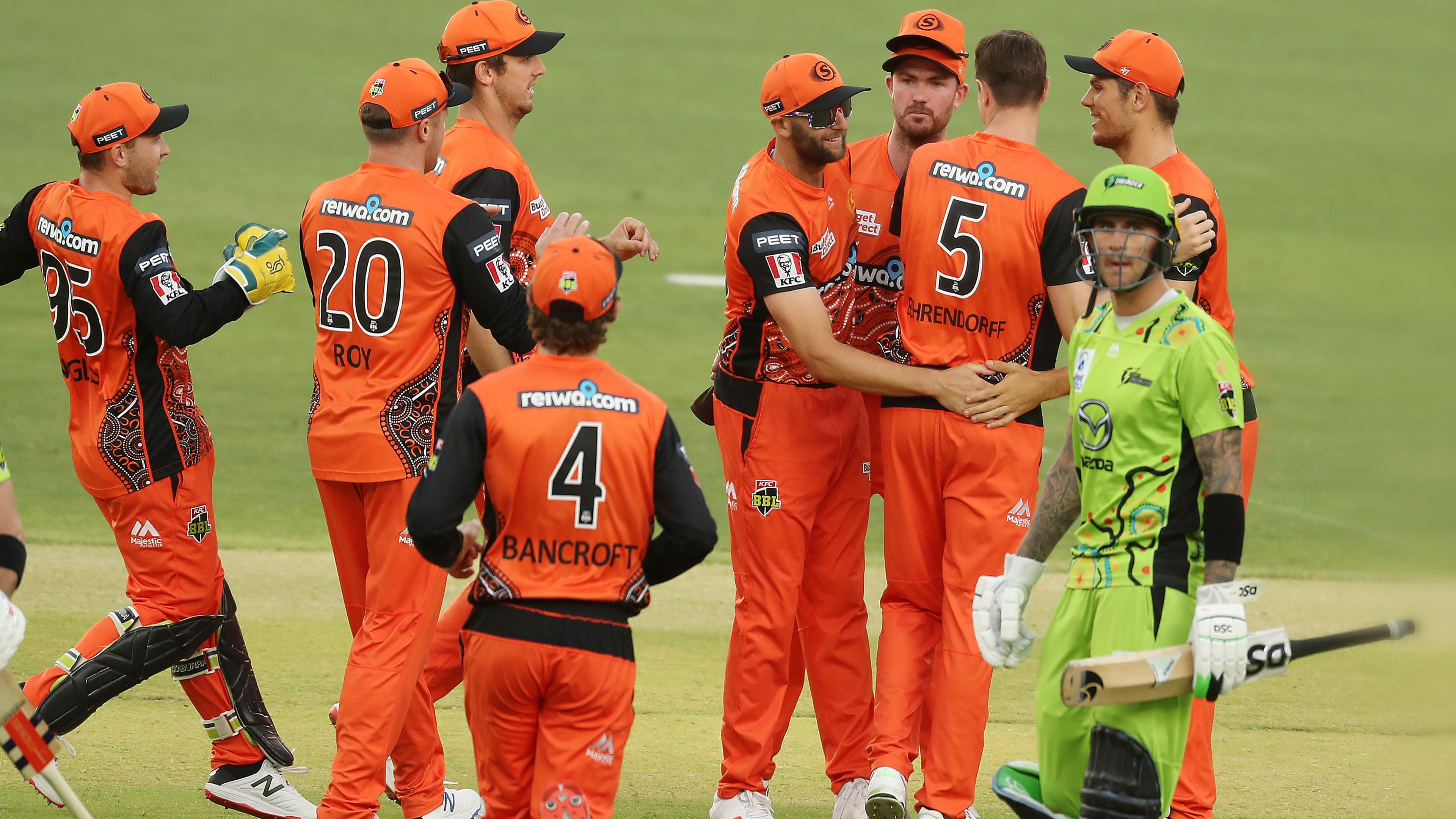 Andrew Tye of the Scorchers  celebrates after taking a catch to dismiss Callum Ferguson of the Thunder.