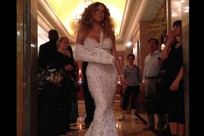 """According to <i>Unusually Stupid Celebrities: A Compendium of All-Star Stupidity</i>, Mariah Carey pays a """"petite Colombian woman"""" to keep her dresses from touching the floor."""