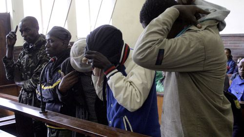 The five suspects flesh-eating case appear at the Estcourt Magistrates Court on August 28, 2017 in Estcourt, South Africa. Nino Mbatha, 32, Sithembiso Doctor Sithole, 31, also an inyanga, Lindokuhle Masondo, 32, Khayelihle Lamula, 32 and Lungisani Magubane, 30 are facing charges of murder, conspiracy to commit murder and attempted murder after Mbatha shocked police when he told them on August 18 that he was 'forced to eat human flesh and he was tired of it'