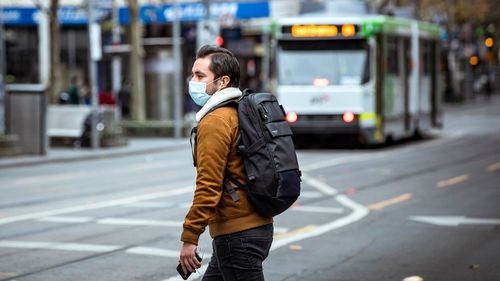 A man wears a face mask due to the Covid-19 pandemic in Melbourne's CBD.