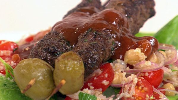Lamb and olive skewers with tomato salad