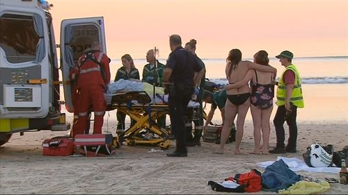 A woman has been saved from drowning at a popular beach south of Adelaide.