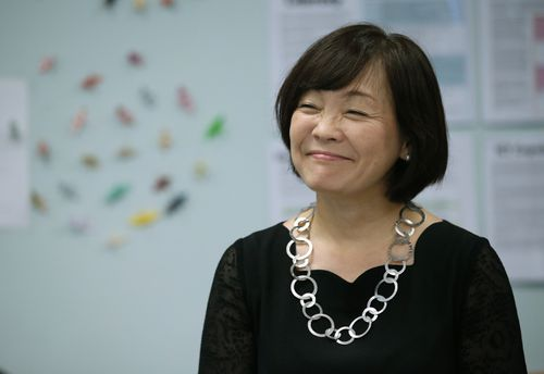 Akie Abe. the wife of Japanese Prime Minister Shinzo Abe, smiles during a visit to a senior elective Japanese language class at Darwin High School.