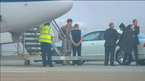 The prince prepares to board a RAAF jet to Canberra. (9NEWS)