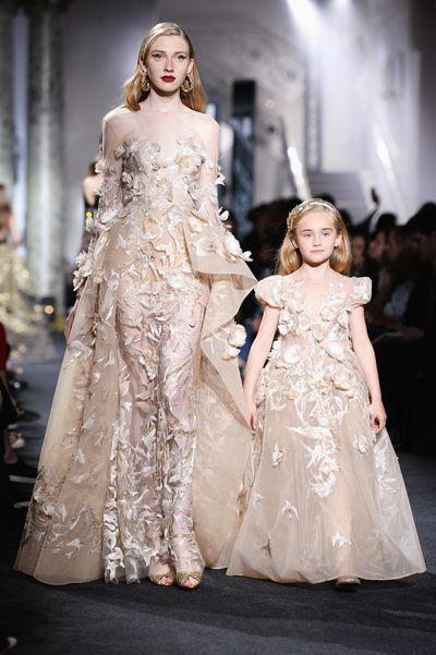 Elie Saab's ornate haute couture wedding gown is always a show-stopping moment, but this season  the runway bride was almost overshadowed by an army of mini-mes in matching couture gowns. Seven models walked the runway with a pint-sized companion in a children's version of the original dress. Click through to see all the adorable pairings.