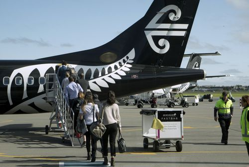 Passengers on board an Air New Zealand flight were frustrated by a woman who deliberately ignore directions from the flight crew to pay attention to the safety briefing.