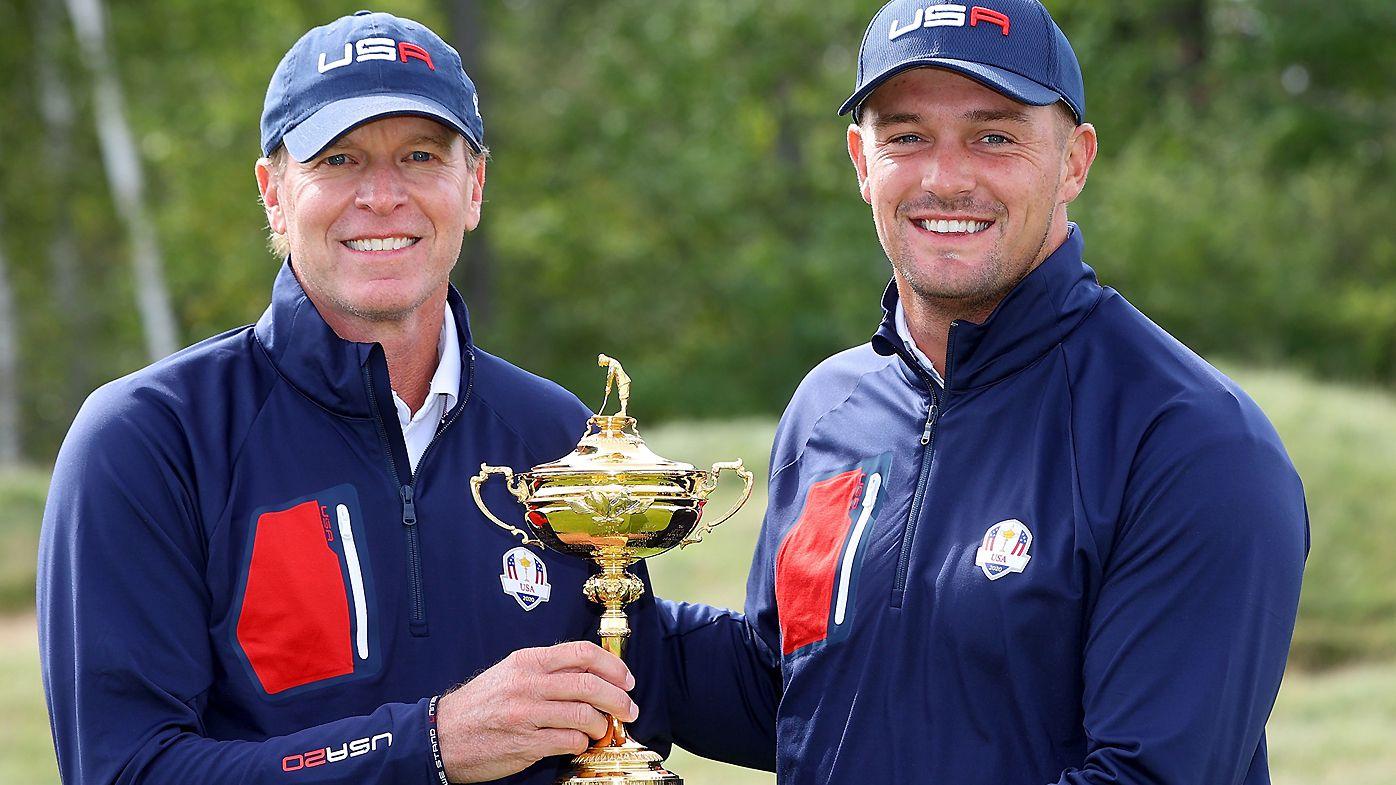 Captain Steve Stricker of team United States (L) and Bryson DeChambeau of team United States