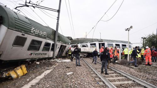 Train carriages were left as crumpled wrecks following the crash. (AAP)