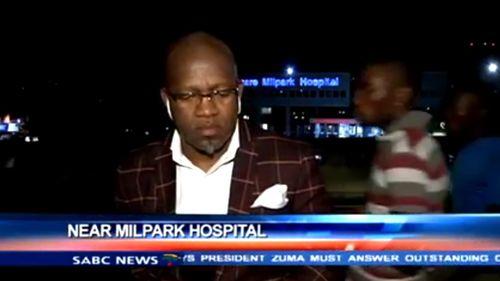 South African news presenter Vuyo Mvoko waiting for the live cross