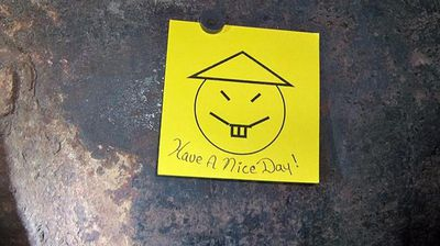 """After leaving a note telling staff to """"have a nice day"""", along with a smiley face drawn in the shape of an Asian caricature, the pair shimmied down six storeys to a tunnel of pipes. <p></p> <p></p>"""