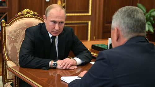 Russian president Vladimir Putin listens to a report of Defence Minister Sergei Shoigu about fire inside deep water mini-submarine.
