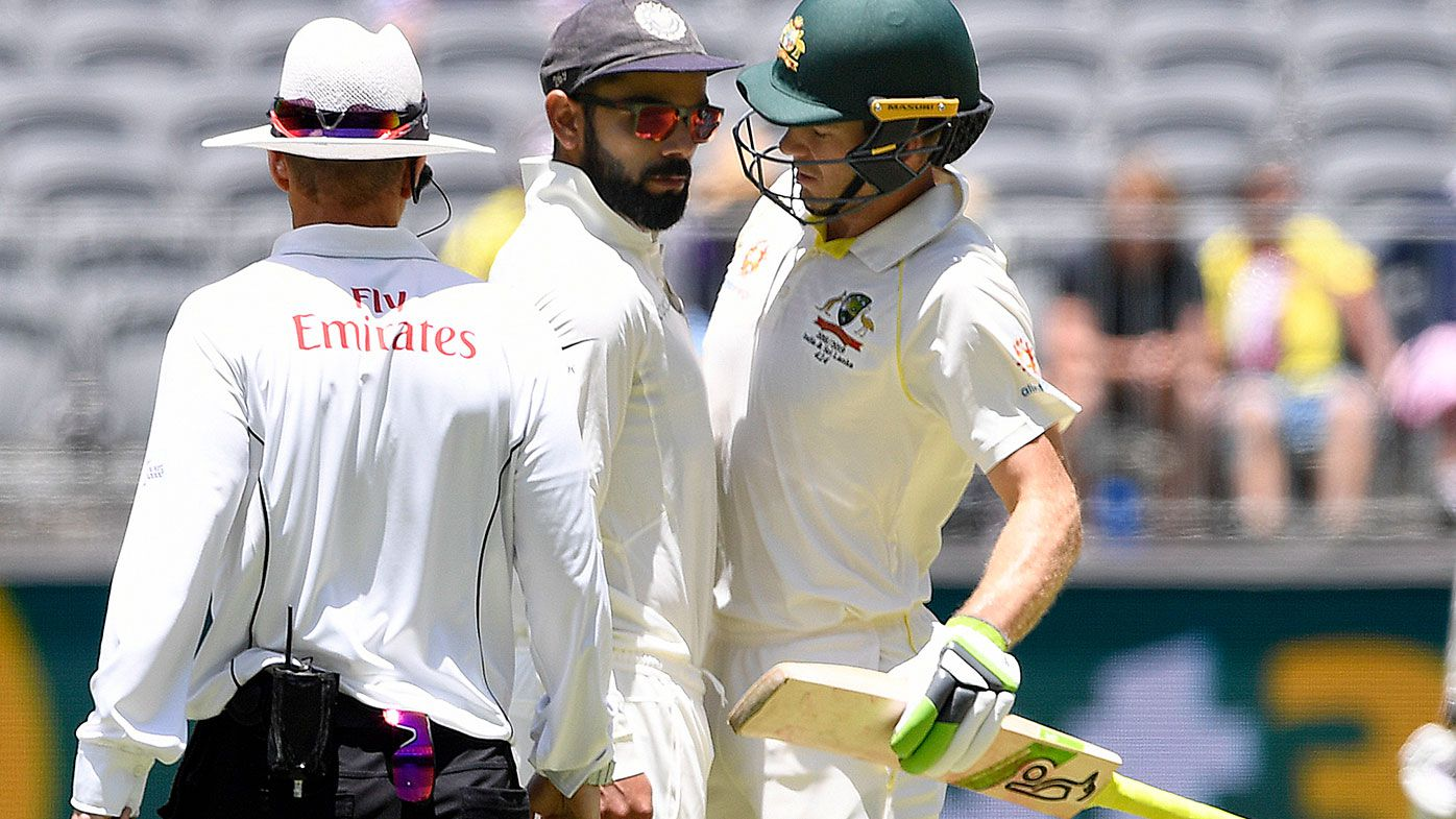 Tim Paine and Virat Kohli during the second Test.