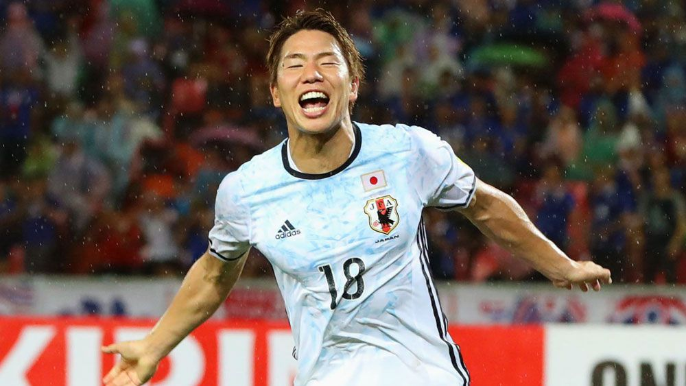 Takuma Asano scores in Japan's 2-0 win over Thailand. (AAP)