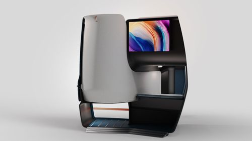 The back of the seat is likely to be adjacent to the screen of the passenger seated behind it.