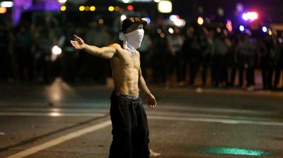 Protesters in Ferguson have been ensuring their hands are visible when confronting police. (AP)