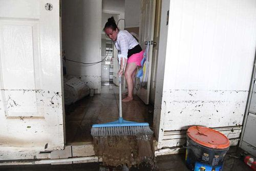 Homes are filled with mud from the water.