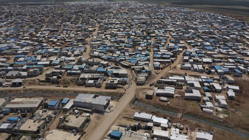 This April 19, 2020 file photo shows a large refugee camp on the Syrian side of the border with Turkey, near the town of Atma, in Idlib province, Syria.