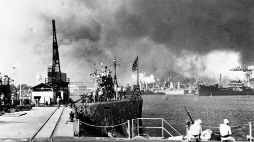USS Tautog (left) and USS Narwhal (right) during the 1941 attack on Pearl Harbor. (AAP)