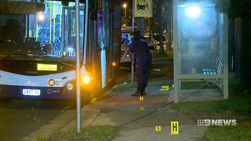 A 22-year-old was arrested and another is on the run after an assault at a Sydney bus stop.
