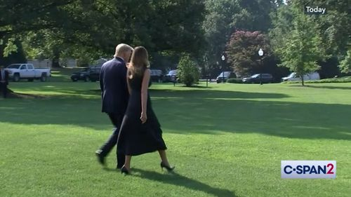 Donald and Melania Trump then walk together to board Marine One.