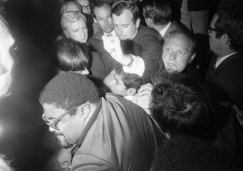 Sirhan Sirhan, then 23, (under raised arm) is pummelled by a crowd, after he shot Senator Robert F. Kennedy in the Hotel Ambassador. (Getty)