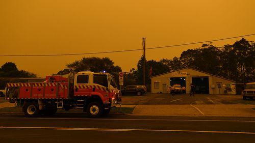 The small village of Bodalla descends into almost darkness at 6.30pm south of Batemans Bay, Saturday, January 4, 2020. The South Coast region on Australia's eastern seaboard, south of Sydney, was devastated on New Year's Eve by bushfire and is under threat again with extreme fire danger, temperatures 40's and strong westerly winds.