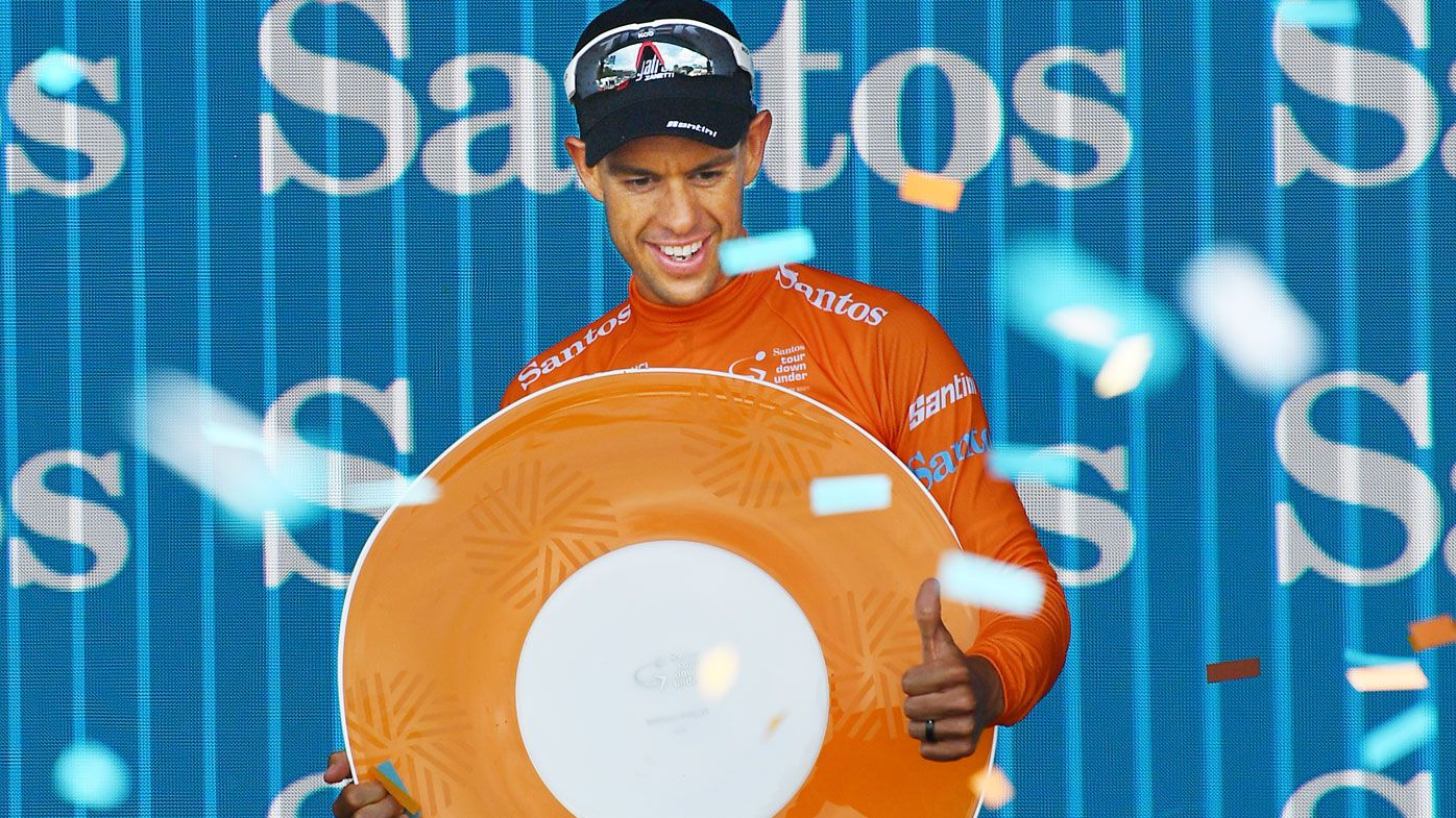 Richie Porte celebrates on the podium after winning the overall title after stage six of the Tour Down Under