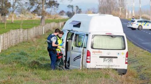 Police inspect a campervan after an Australian tourist was allegedly shot dead.