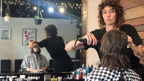 Stephanie Neen, hairdresser at Henry Lee Barbershop, says its impossible to obide by social distancing measures in a hair salon.