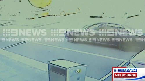 Kilpatrick was seen entering the store, being unable to use the till when the employee fled to a back room and then leaving the scene with a bottle of alcohol in a waiting Commodore. Picture: 9NEWS.
