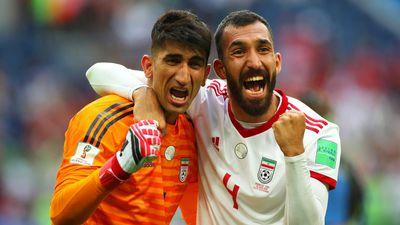 Ali Beiranvand and Roozebeh Cheshmi of IR Irann celebrate.