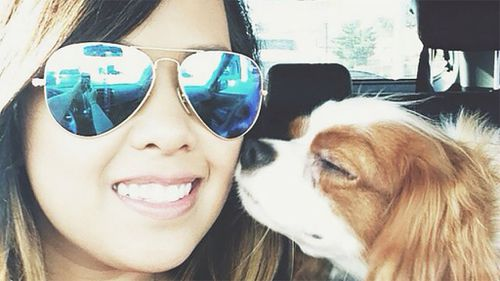 Texas hospital worker Nina Pham, 26, with her dog Bentley. (Supplied)