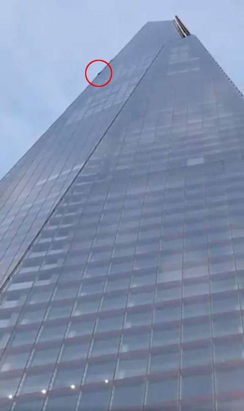 A daredevil free climber scaling The Shard, one of the tallest buildings in Europe.