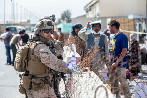 Marines with Special Purpose Marine Air-Ground Task Force-Crisis Response-Central Command provide assistance during an evacuation at Hamid Karzai International Airport in Kabul.