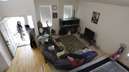 The living room of Jonathan Allen and Ina Rogers' home. (AP)