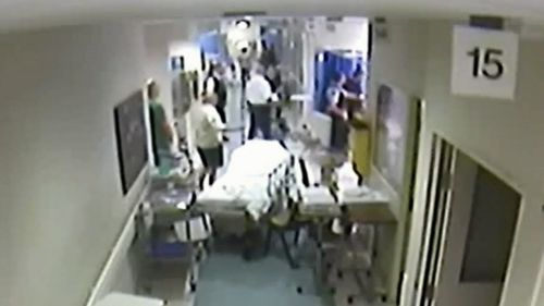 The footage played to the court showed a pool of blood left by Sergeant Warburton as his colleagues pulled him to safety.