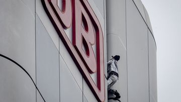 "French urban climber Alain Robert, well known as ""Spiderman"", climbs up the Deutsche Bahn high-rise in central Frankfurt, Germany, Thursday, October 1, 2020"