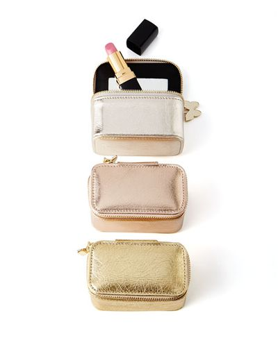 "<a href=""http://www.neimanmarcus.com/en-au/Metallic-Travel-Cases/prod193020001/p.prod?focusProductId=prod191130022&amp;icid=&amp;searchType=MAIN&amp;rte=%2Fsearch.jsp%3Ffrom%3DbrSearch%26request_type%3Dsearch%26search_type%3Dkeyword%26q%3Dtravel&amp;eItemId=prod191130022&amp;cmCat=search&amp;tc=4497&amp;currentItemCount=27&amp;q=travel&amp;searchURL=/en-au/search.jsp%3Ffrom%3DbrSearch%26start%3D0%26rows%3D30%26q%3Dtravel%26l%3Dtravel%26request_type%3Dsearch%26search_type%3Dkeyword"" target=""_blank"">NeimanMarcus Metallic Lipstick Case $90.63.</a>"