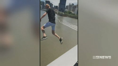 Video shows Mr Erin leaping from Goodwill Bridge into the Brisbane River.  (Luke Erwin 23 / Facebook)
