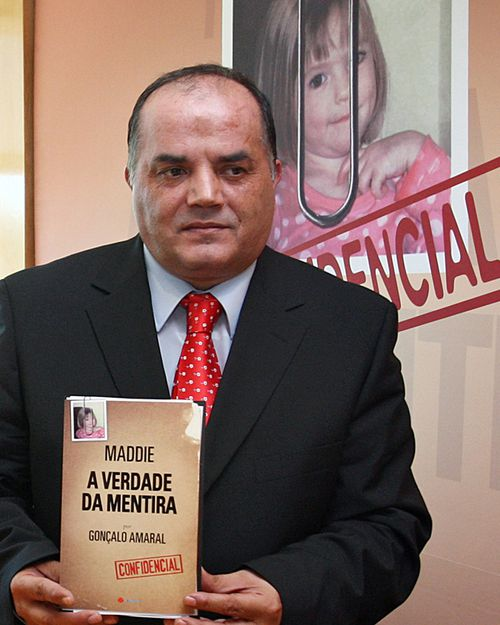 """Former Policia Judiciaria detective Goncalo Amaral holds a copy of """"Maddie: The Truth about the Lie"""" at its launch in Lisbon on July 24, 2008. Amaral led the investigation on the McCann case until he was removed from the case."""