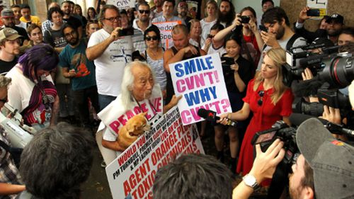 Sydney activist Danny Lim is seen outside of Sydney City Police Area Command, Sydney, Sunday, January 13, 2019. Protestors have gathered to rally against what they say is the brutal arrest of well known Sydney activist Danny Lim, who is 74-years-old